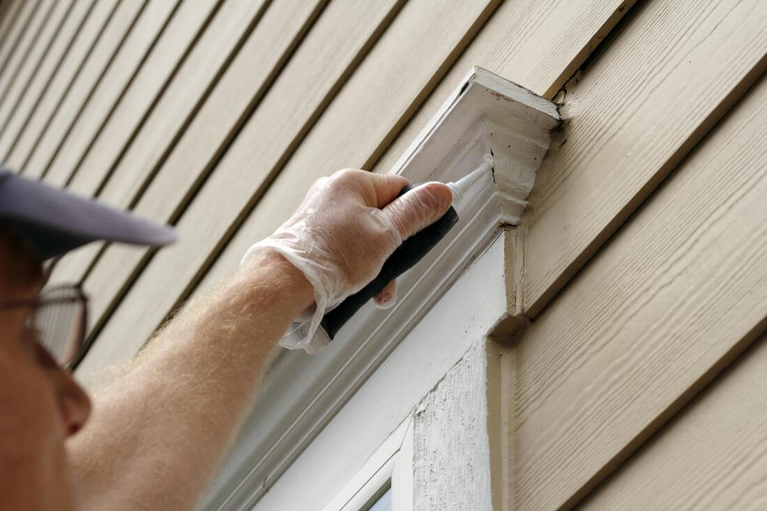 professional painter performing exterior house painting